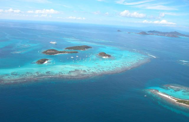 "The Tobago Cays, the horseshoe reef and Petit Tobac, one of the ""must sees"" during a Grenadines sailing trip"